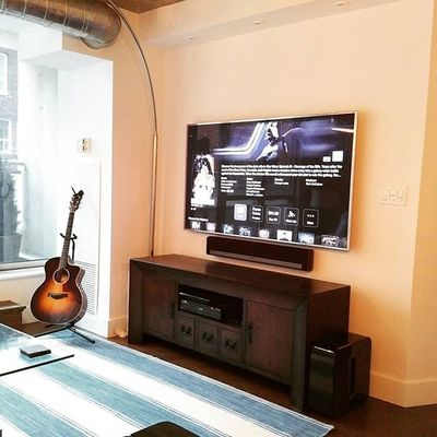"A 65"" #Samsung #UN65JS8500 #SUHD #4K TV mounted on a #Sanus articulating mount. A  #Sonos #Playbar and #Sub fill this #BachelorPad with #AllTheMusicOnEarth  #TaylorGuitars #AppleTV #StarWars"
