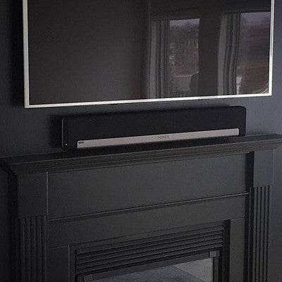 "Sonos Playbar and 55"" tv installed above a fireplace. Sonos subwoofer elsewhere in the room. clean and simple! #baybloorradio #sonos @sonos #playbar #tv #samsung #installation #customdesign #design #custom #doneright #homedecor #simple #clean #av #fireplace #livingroom #audio #music #sound"