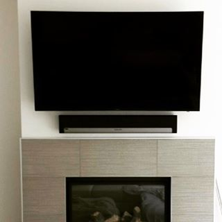 The elegance of a tv above a fireplace.  We are convinced there is nothing better‼️  #television #wednesday #nhl #playbar #victoriabc #vinyl #samsung #vanislelife #wall #fireplace #wallmount #sonos #game7 #island #local #tv #yyjmusic #deals #yyjarts #vancouverisland #yvr #yyjdesign #turntable #playbase #custominstall #yyjdeals