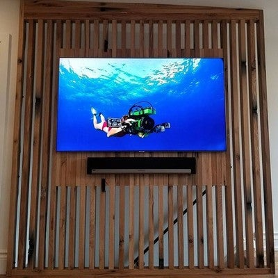 "A 65"" #Samsung #Q7 using a #gapless wall mount with a #Sonos and #Paradigm #SurroundSound system. This is installed on a stairway partition made of #reclaimedwood from the #WellandCanal.  Partition designed by @alisonmilnegallery  and perfectly executed by @paus_inc Reno and construction management by @baronbuilding.  AV components are located in a #Middleatlantic #Rack and kept under control using @urcinsta and #Wattbox #UN65Q7F #Playbar #SonosSub #ParadigmSpeakers #KeyDigital #Scuba #4K #UHD"