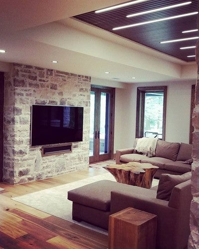 "We installed A 75"" #Samsung #KS8000 with a full #Sonos surround sound system including a recessed #Playbar, #Sub and pair of #Paradigm in-ceiling speakers powered by a #ConnectAmp. Lighting Control by #Lutron.  Video distribution by  #Atlona,  control by #URC. . . . #LightingControl #LED #SlatCeiling #Stonework #Rustic #RusticFurniture #InteriorDesign #SurroundSound #Hometheater #TV #HomeAutomation"