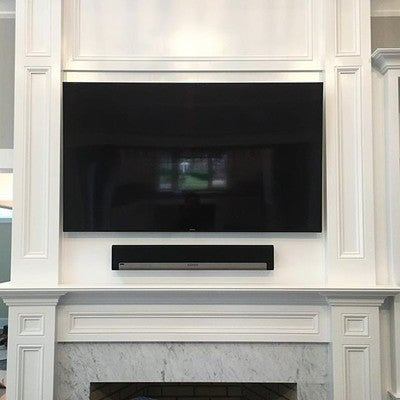 TV and soundbar over a fireplace #sonos #sony #4k #hdr #roku #control4 #controlsystem #playbar #tv #tvhangs #cciav #luxury #luxurylifestyle #luxuryhomes #newyork #longisland