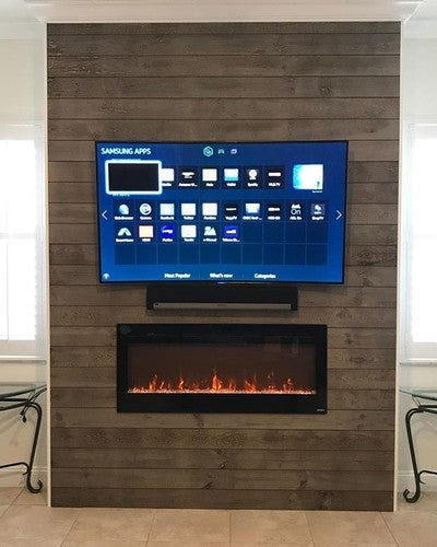 "85"" #Samsung #8series #Curved #UHDTV #Smart #LED on a Tilt Mount, Wall Mounted #Sonos #Playbar Hidden Wires, New Outlet made behind the#TV and Glass #FirePlace #orangetvinstallation #louiegotyou #wegotyoucovered #wegoallover #wegetitdone"