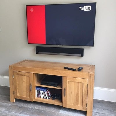 A TV Wall Mount With A Sonos Playbar, All Cables Hidden From View And Set