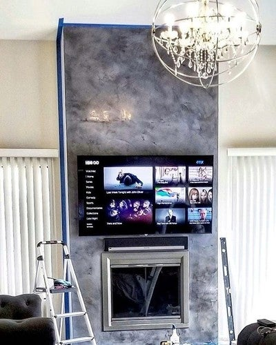 Finishing up the fireplace!  #homeremodel #marble #chandelier # #fire #fireplace #tv #sonos #playbar #sonosplaybar #home #remodel #upgrade